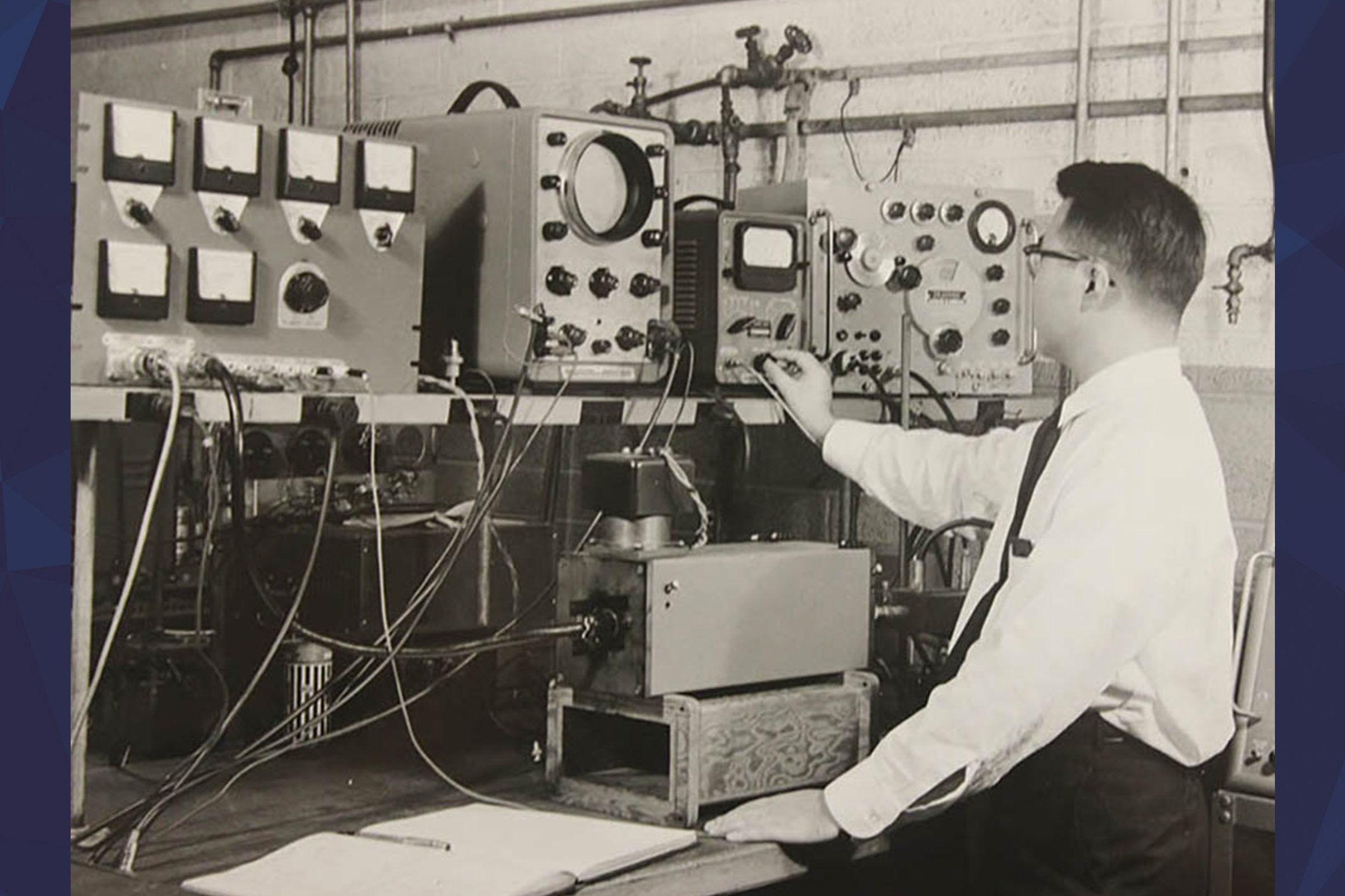 A researcher adjusting the radio signals with wall of dials