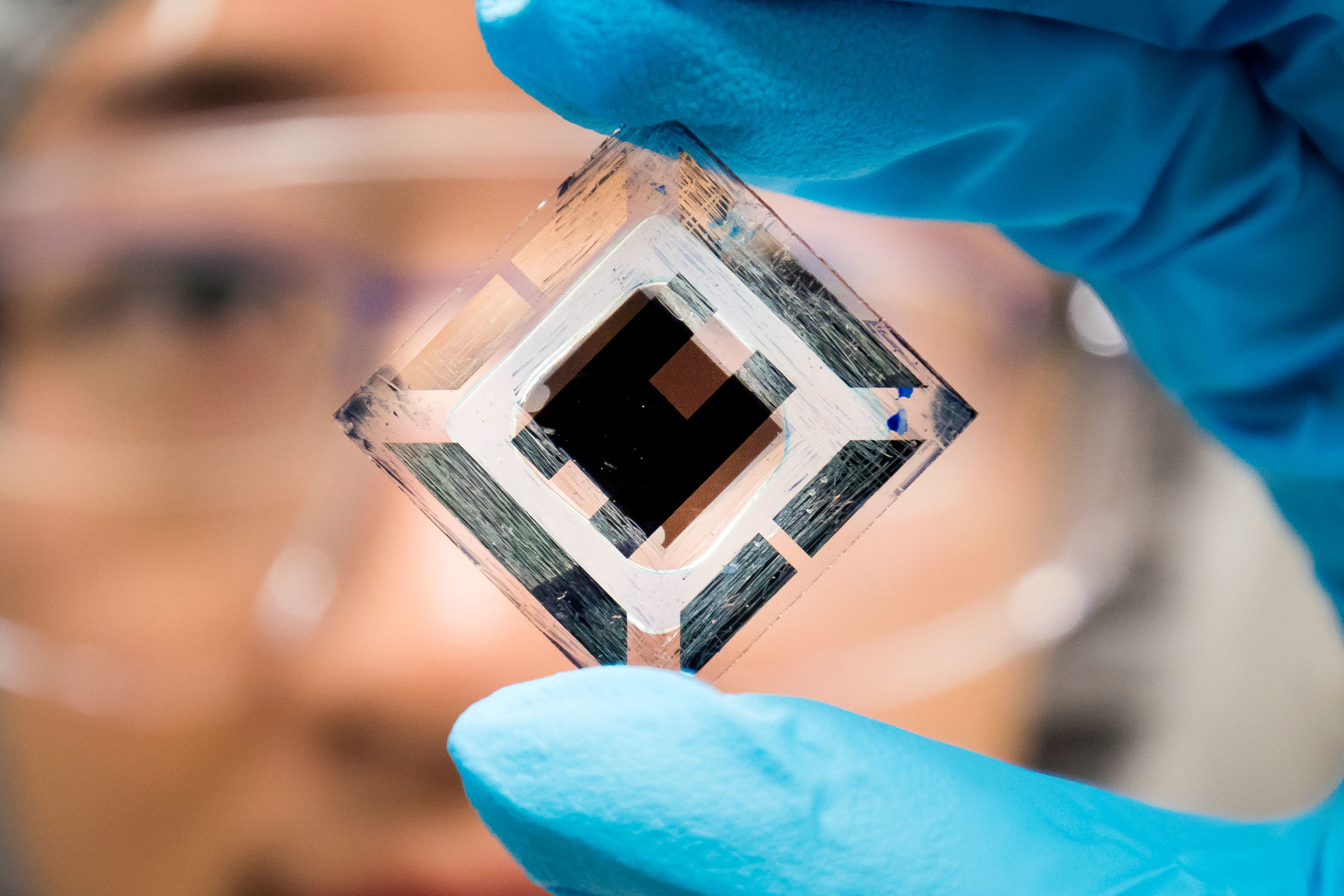 a photo of solar tech in the hands of a scientist