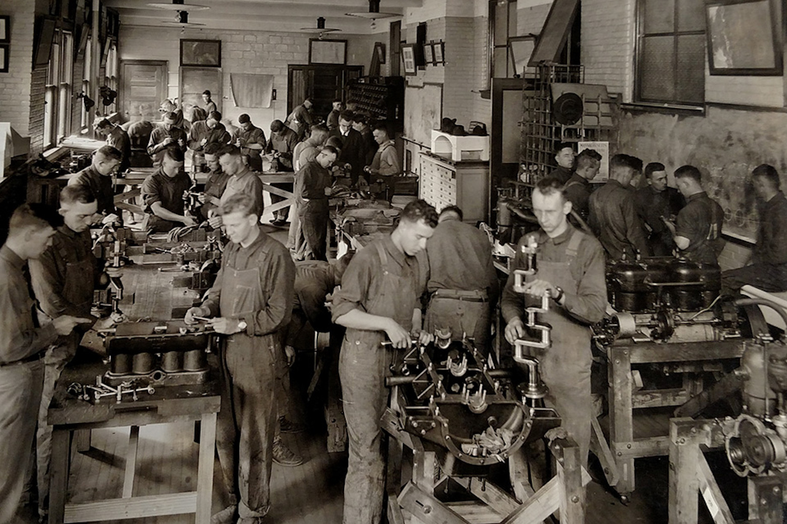Men working on car parts in assembly line