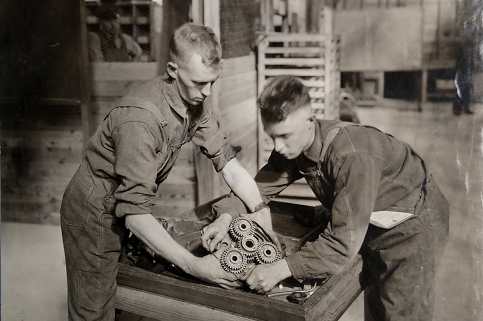 2 men working on with car part