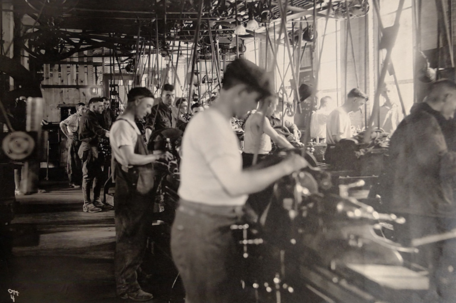 Men working on cars in an assembly line