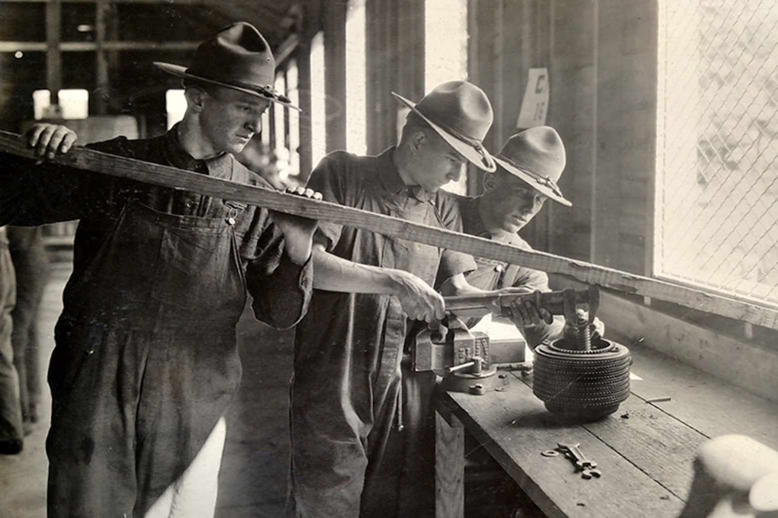 3 men working with tools