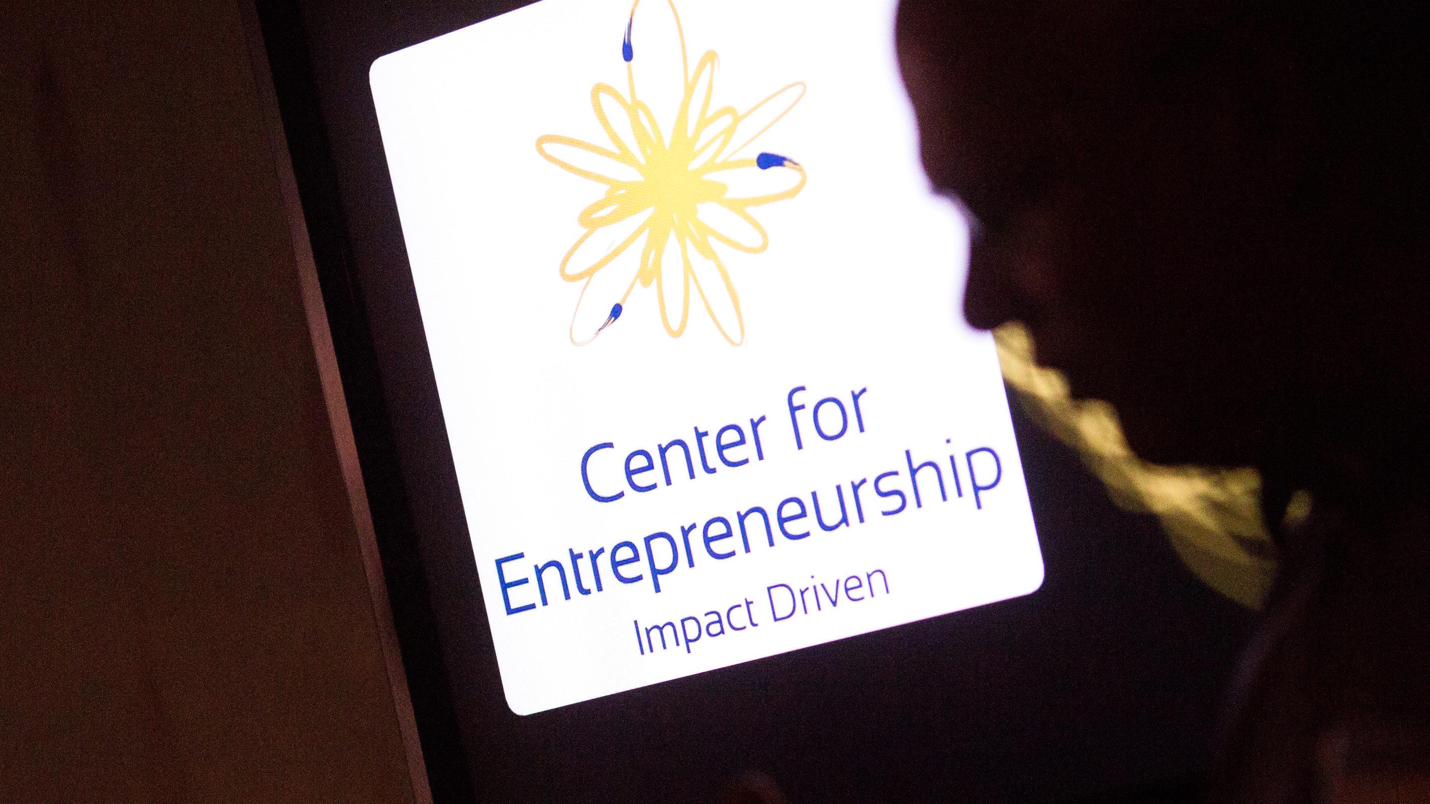 a photo of a face next to a sign for Center for Entrepreneurship