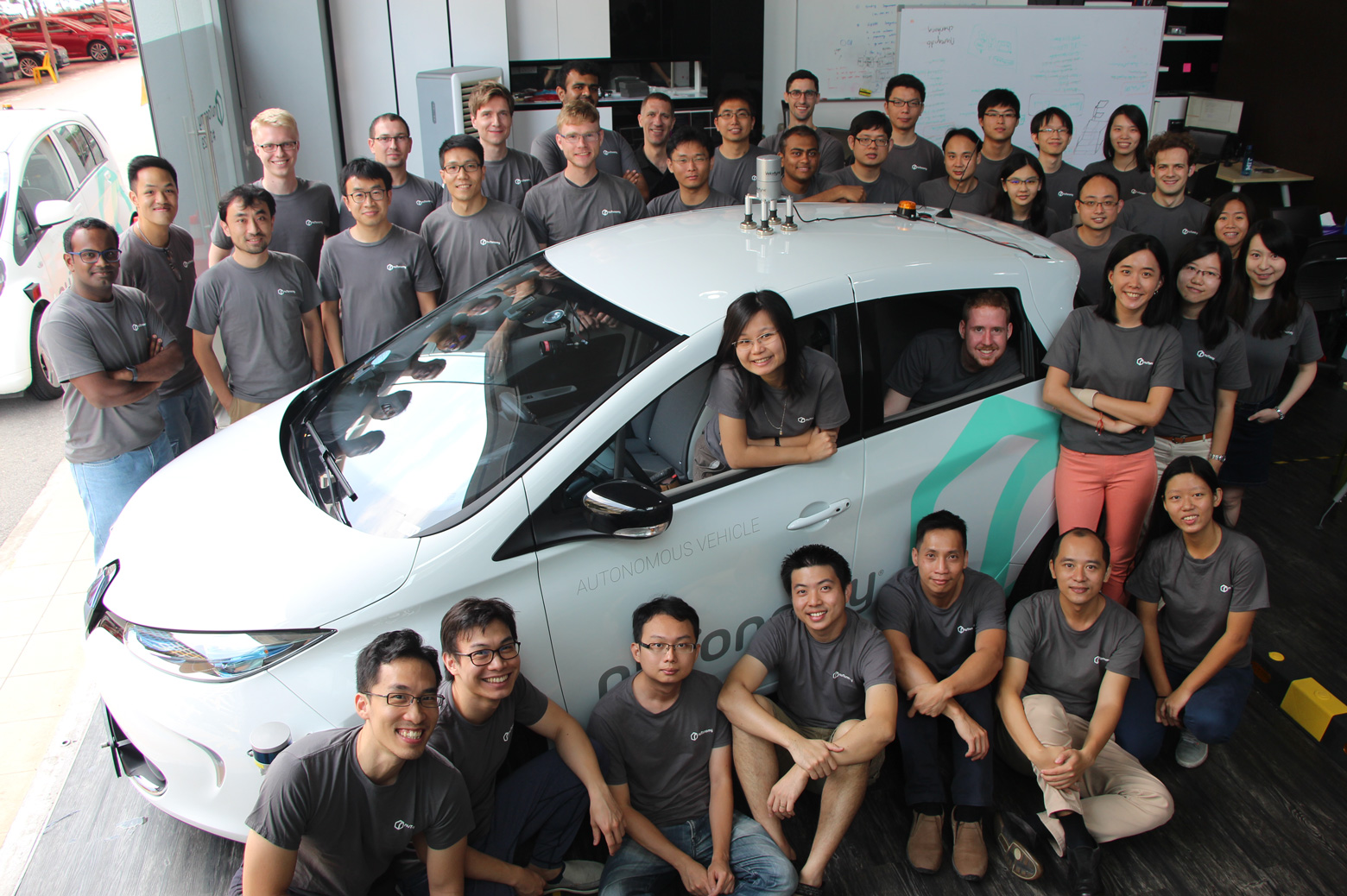 the nutotonomy team with its car