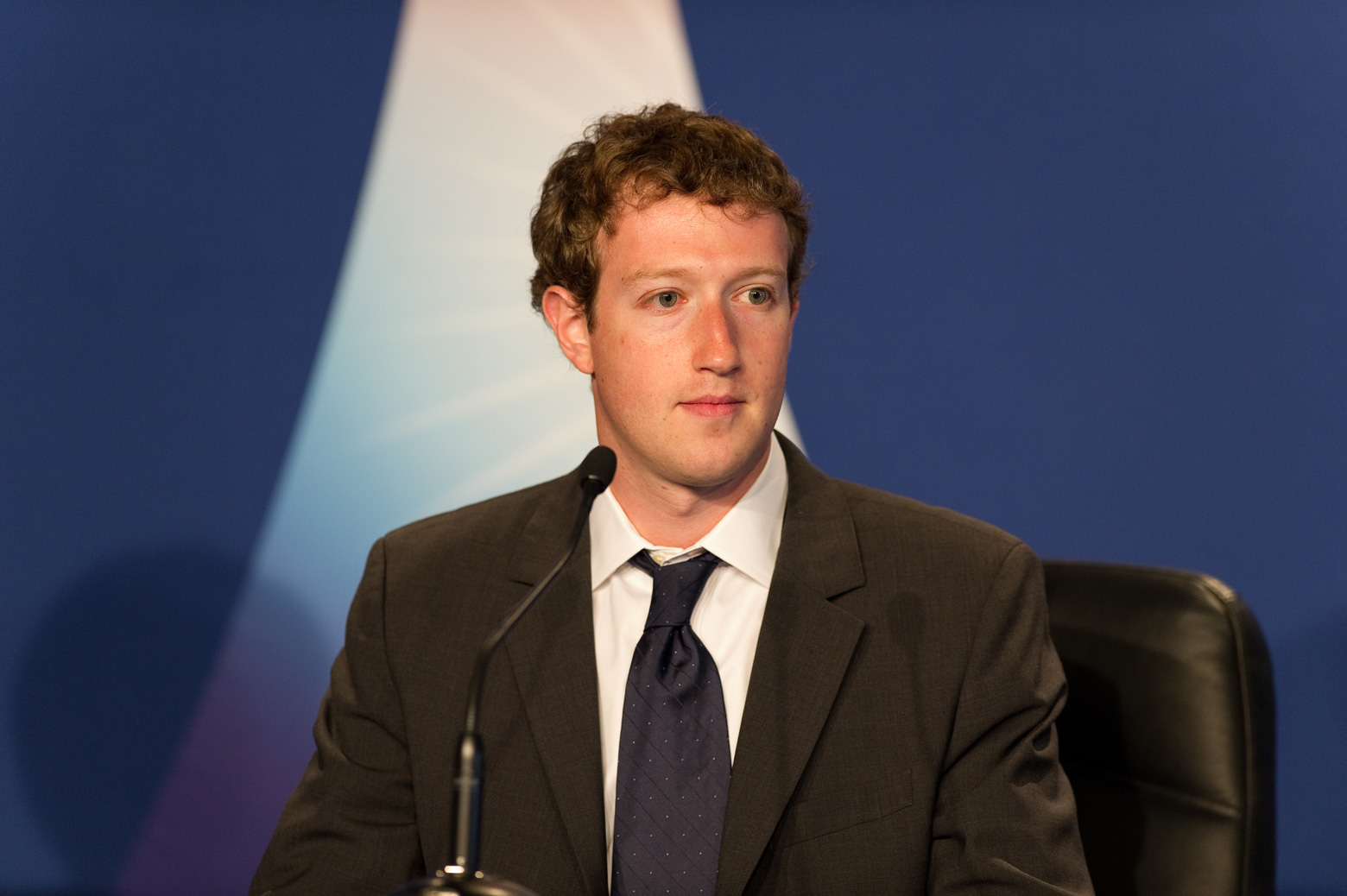 Facebook CEO Mark Zuckerberg seated at a table