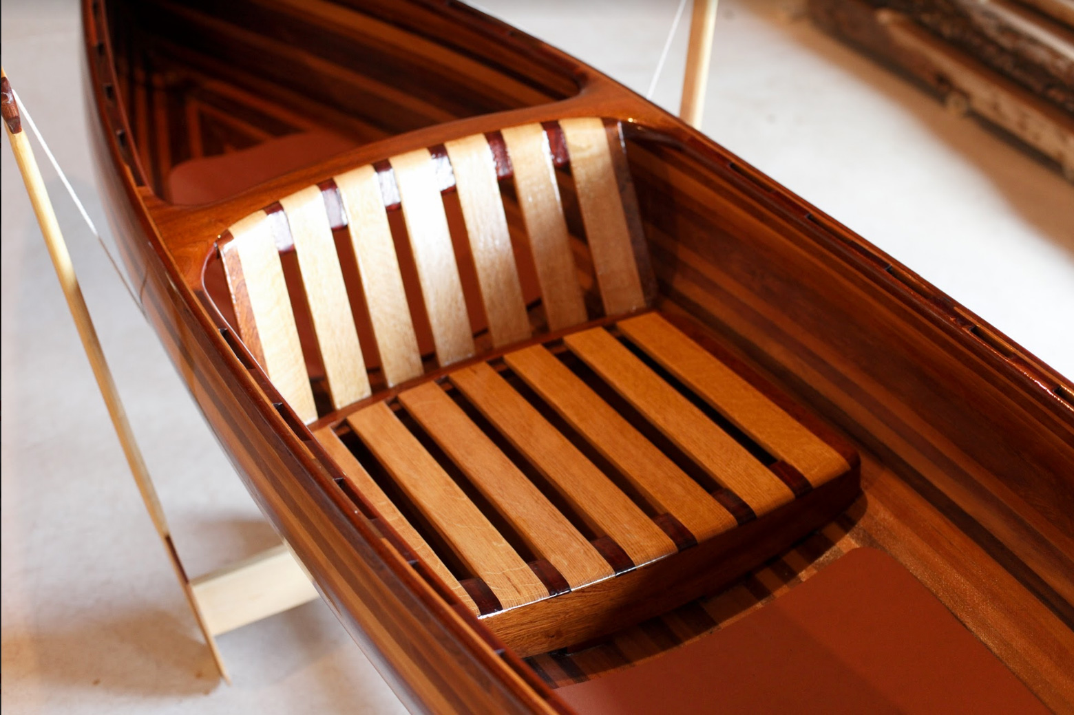a photo of a wooden boat seat