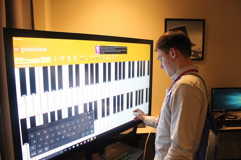 Student interacting with touch screen