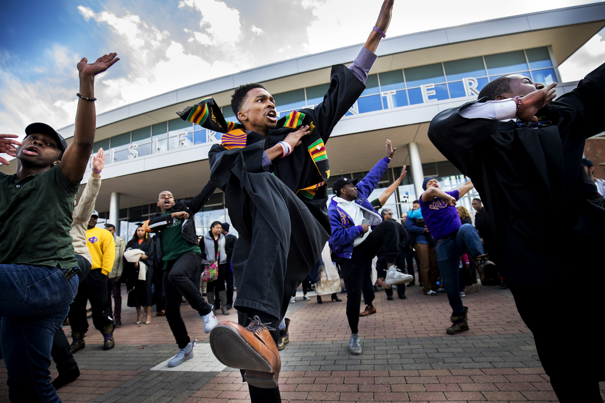 A group of graduating seniors performing a step routine after the Spring 2018 Commencement at Crisler Center.