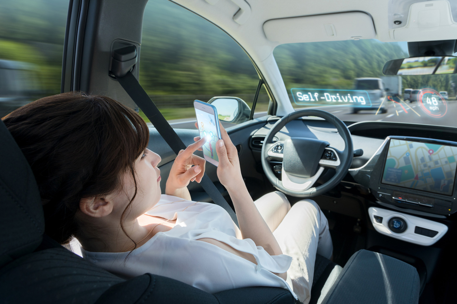 woman using smart phone in autonomous car