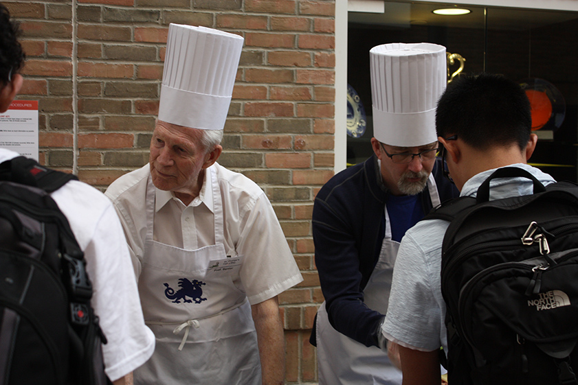 Tom serving the students