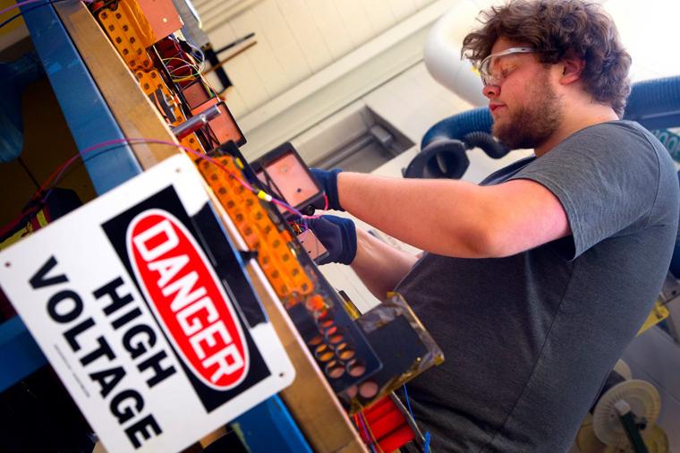 Brad assembling a battery