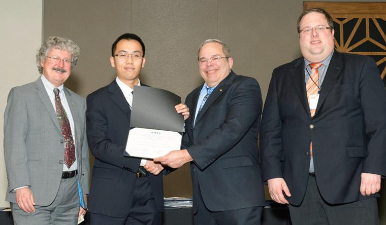 wang receiving the award