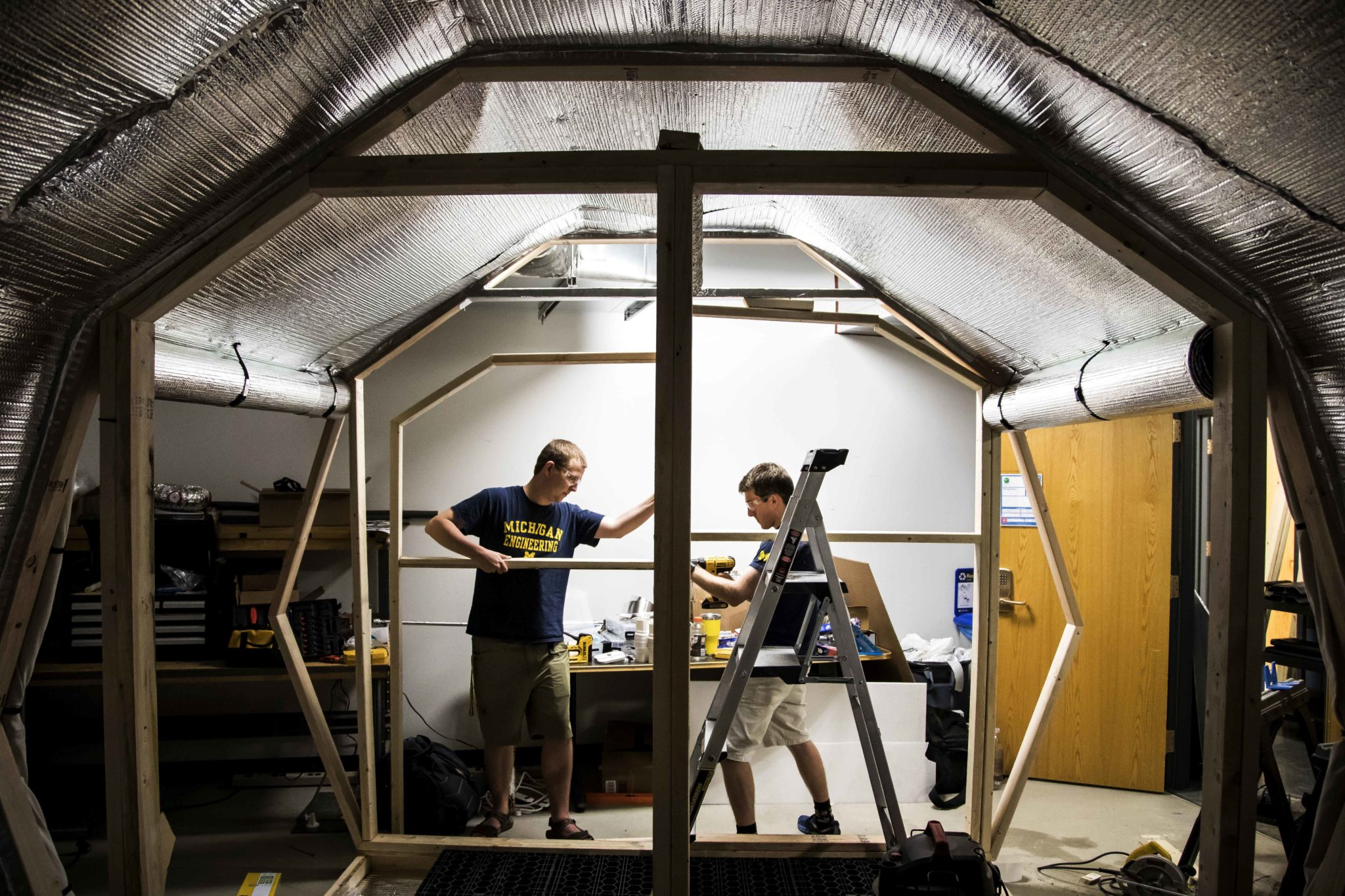 Members of the Michigan Bioastronautics and Life Support Systems (BLiSS) team construct a Mars Habitat in the basement of the Space Research Building.