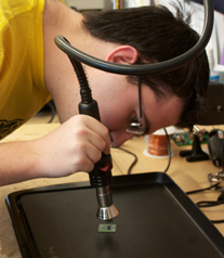 student solders a pcb
