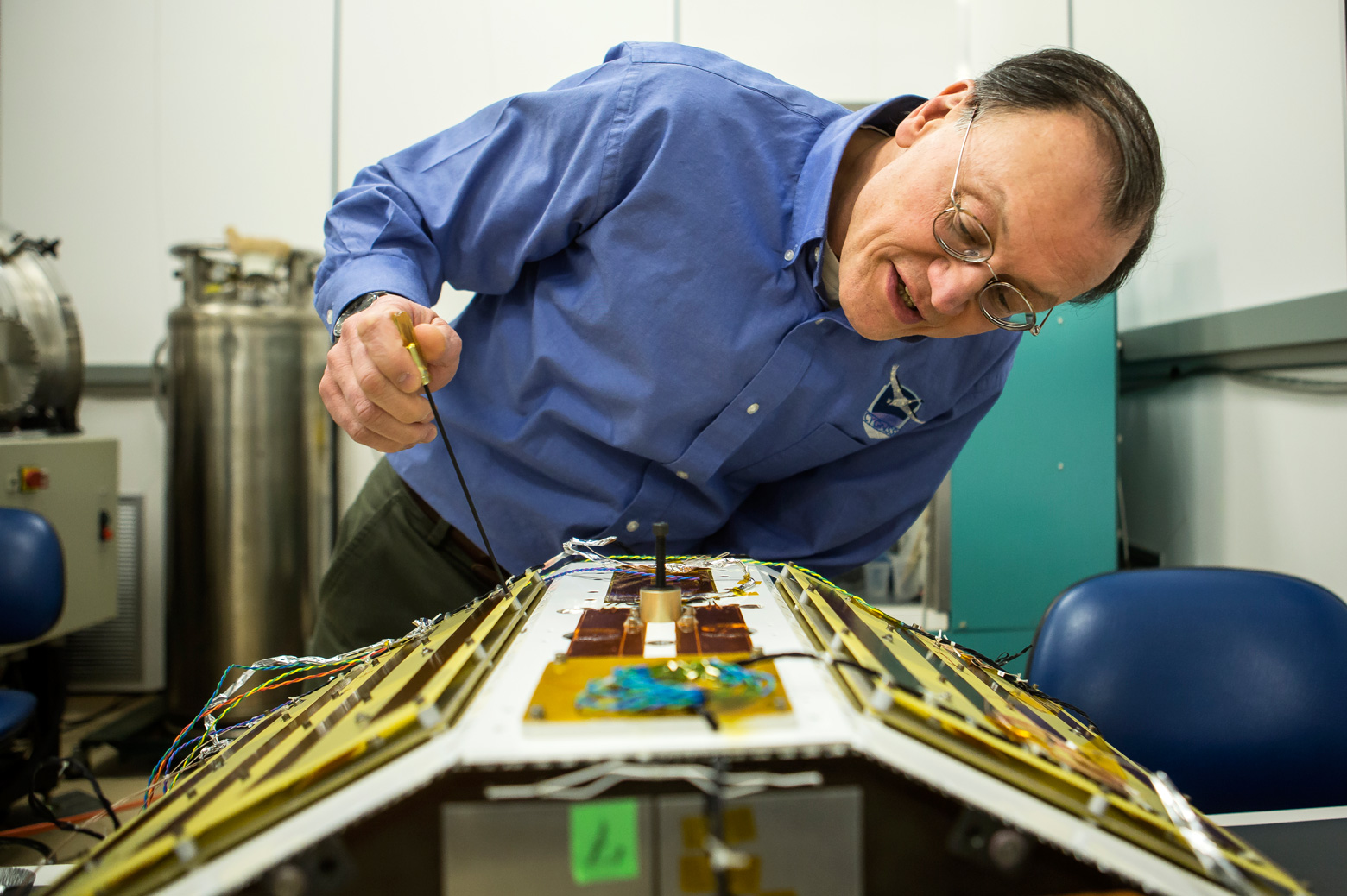 Chris Ruf inspects a CYGNSS prototype