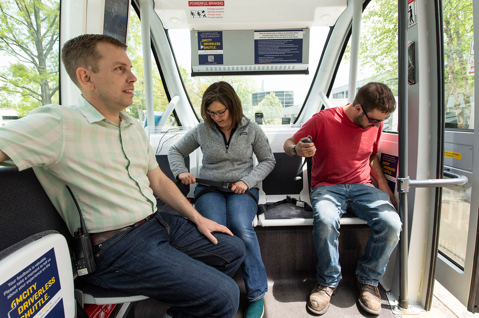 Passengers sit inside the Mcity Driverless shuttle