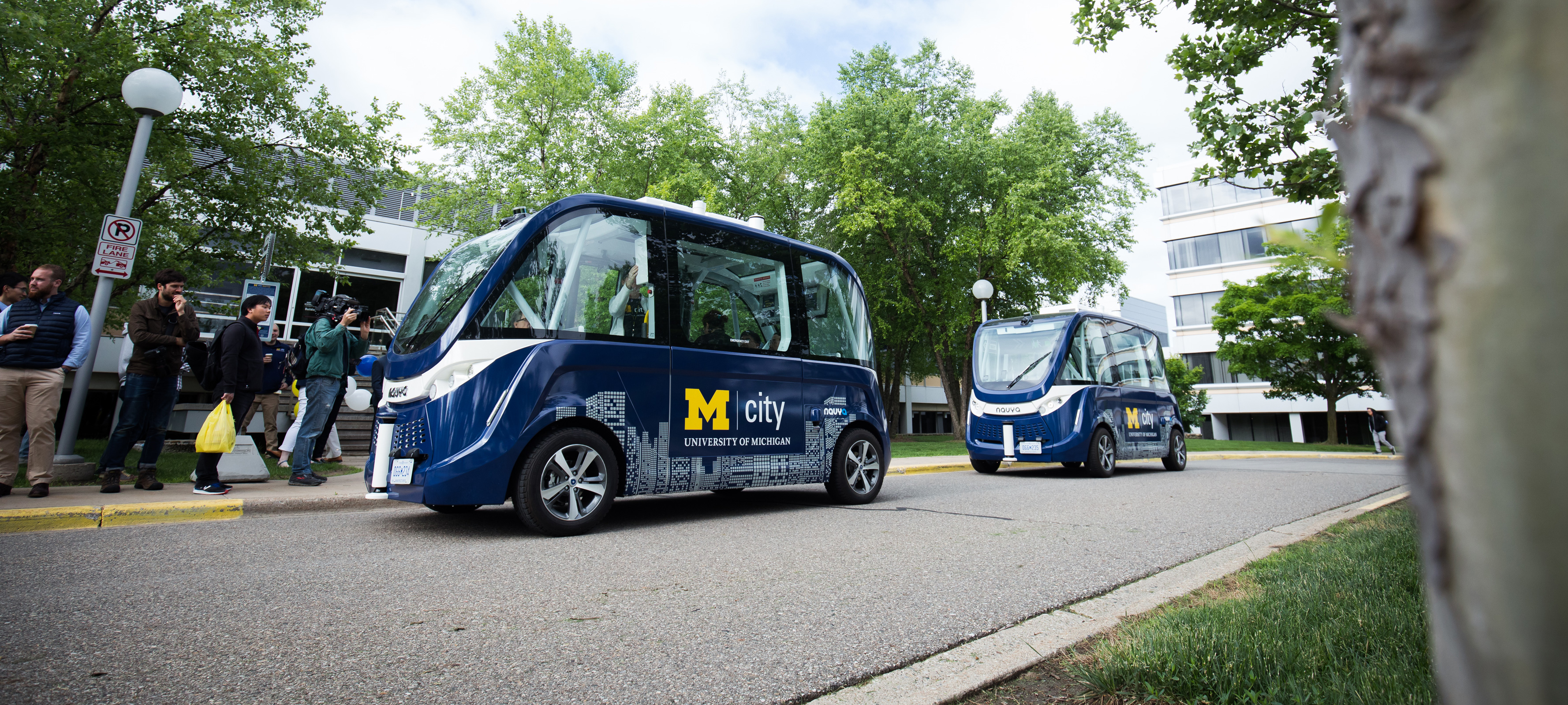 two driverless shuttles parked on the road