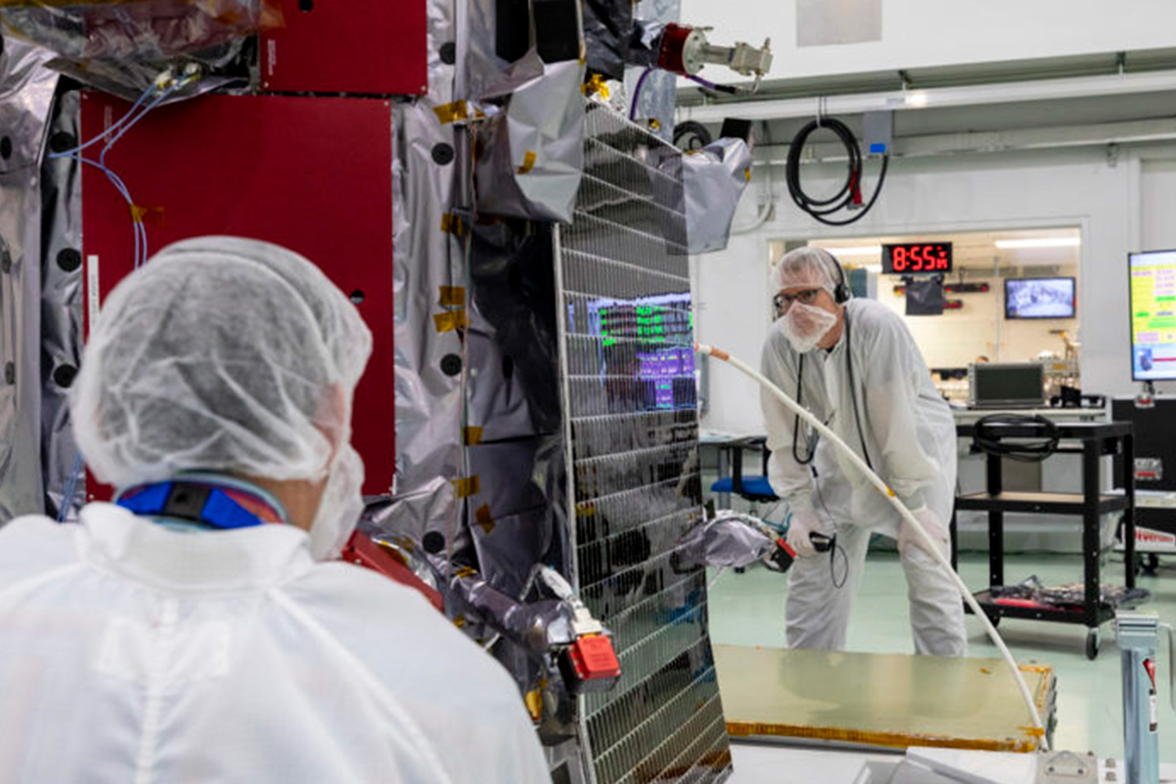Members of the Parker Solar Probe team examine and align one of the spacecraft's two solar arrays on May 31, 2018. Credit: NASA/Johns Hopkins APL/Ed Whitman
