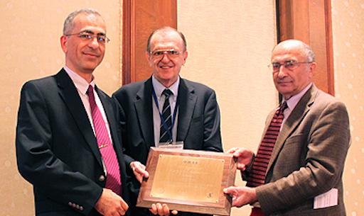 Najafi receiving award