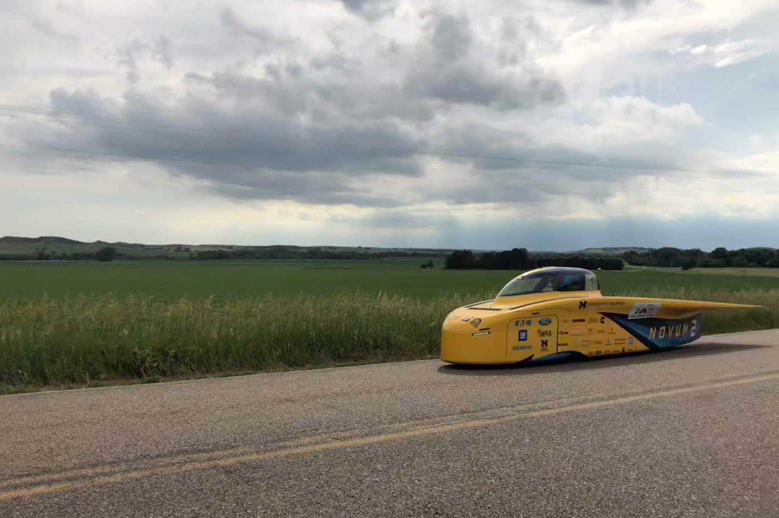 The University of Michigan solar car Novum contends with clouds during a practice run on the American Solar Challenge race route.