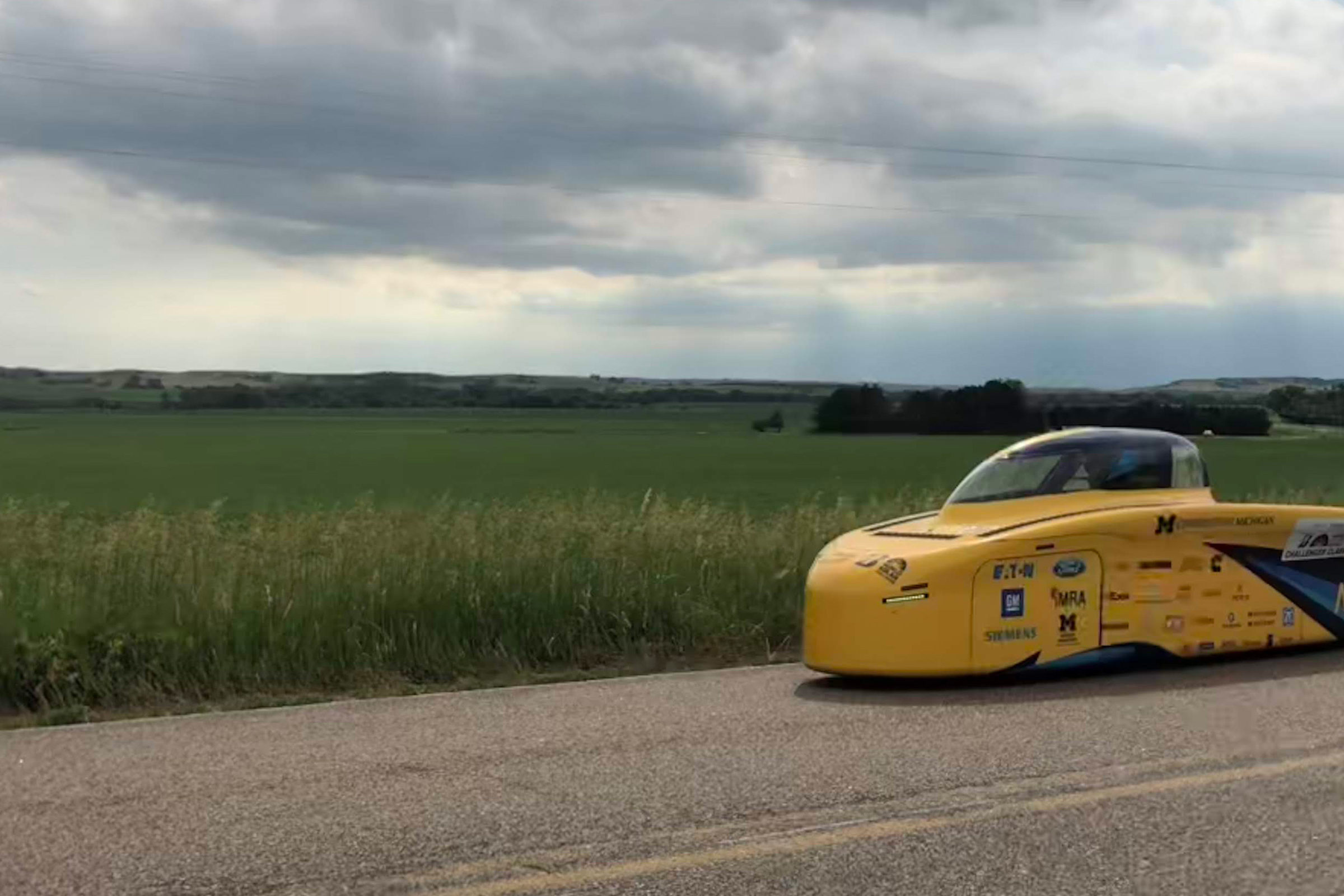 The University of Michigan solar car Novum contends with clouds during a practice run on the American Solar Challenge race route