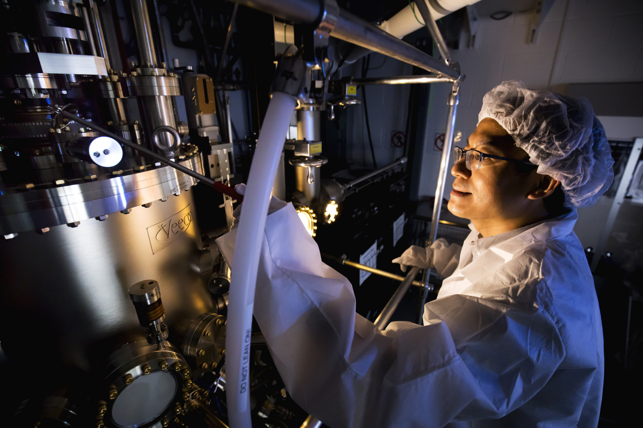 A photograph of a researcher in lab.