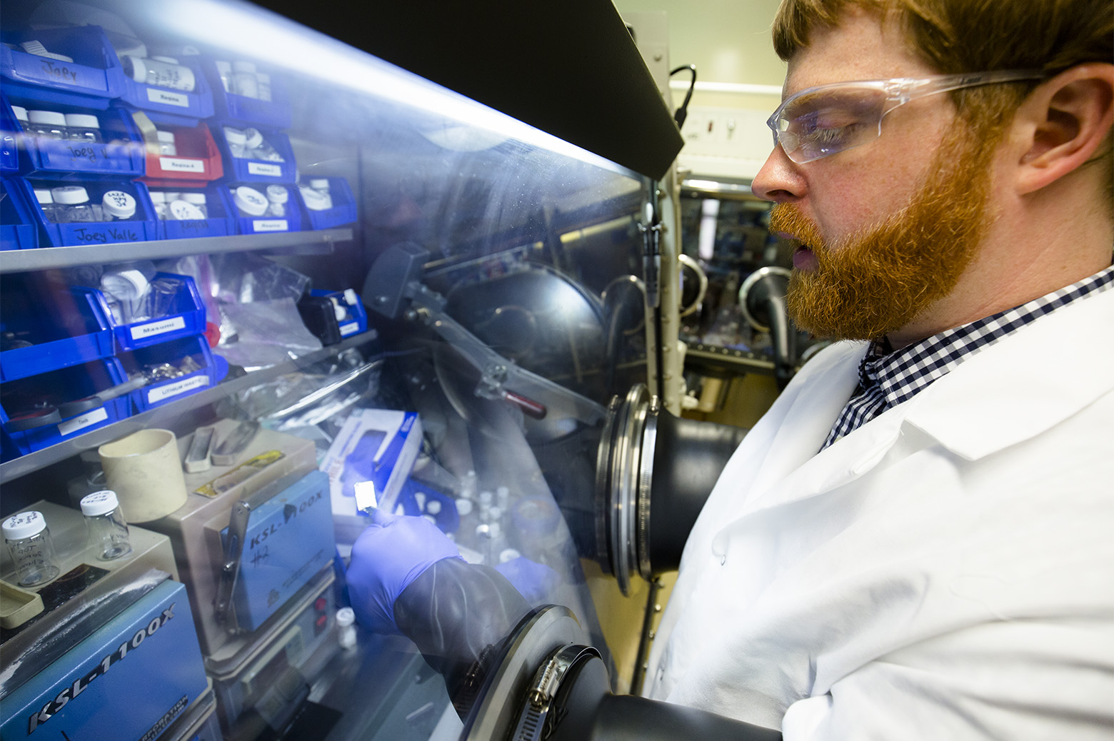 Nathan Taylor, a post-doctoral fellow in mechanical engineering, inspects a piece of lithium metal in the Phoenix Memorial Laboratory building at the University of Michigan on August 7, 2018 in Ann Arbor, MI.