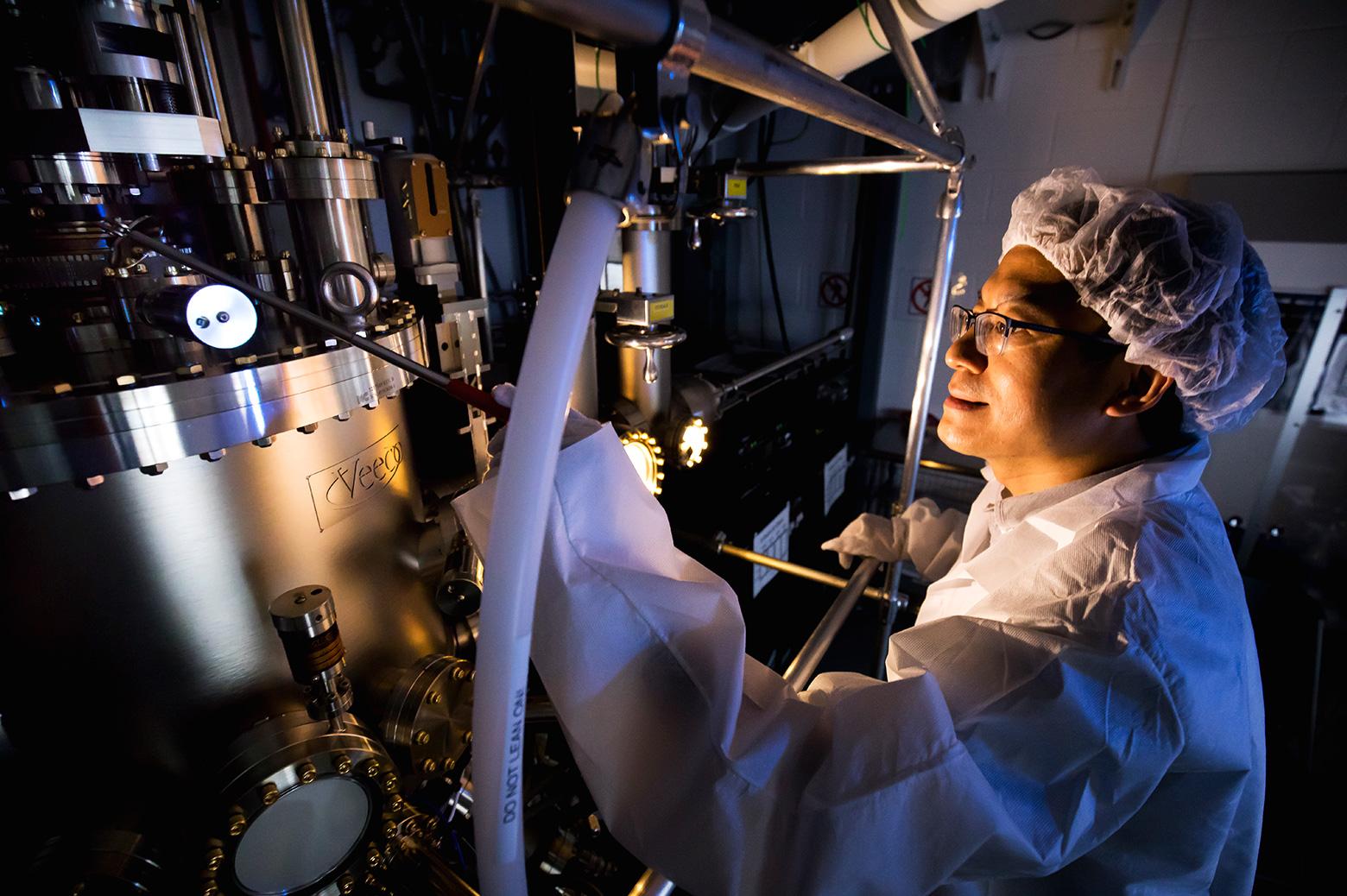 Zeitan Mi runs a sample through the Scalable Quantum Engineering and Manufacturing (SQEM) technique