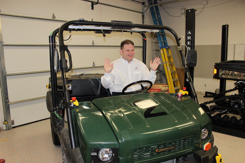 Rohde in golf cart
