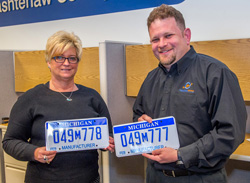 People holding license plates