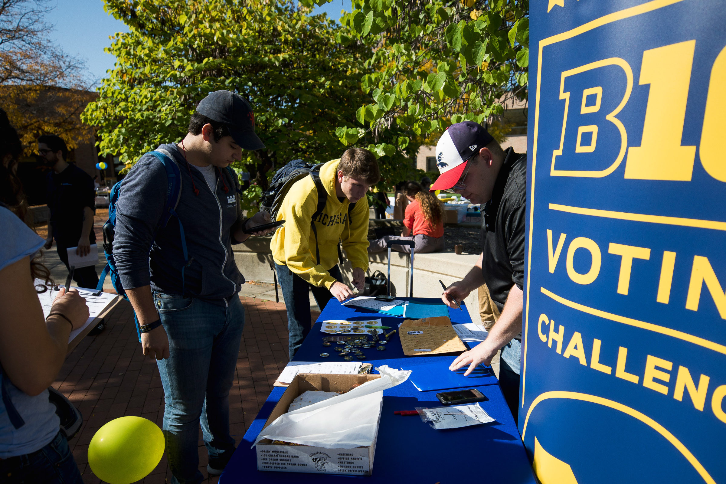 Students register to vote at the impactXchange on North Campus of the University of Michigan. Photo: Joseph Xu