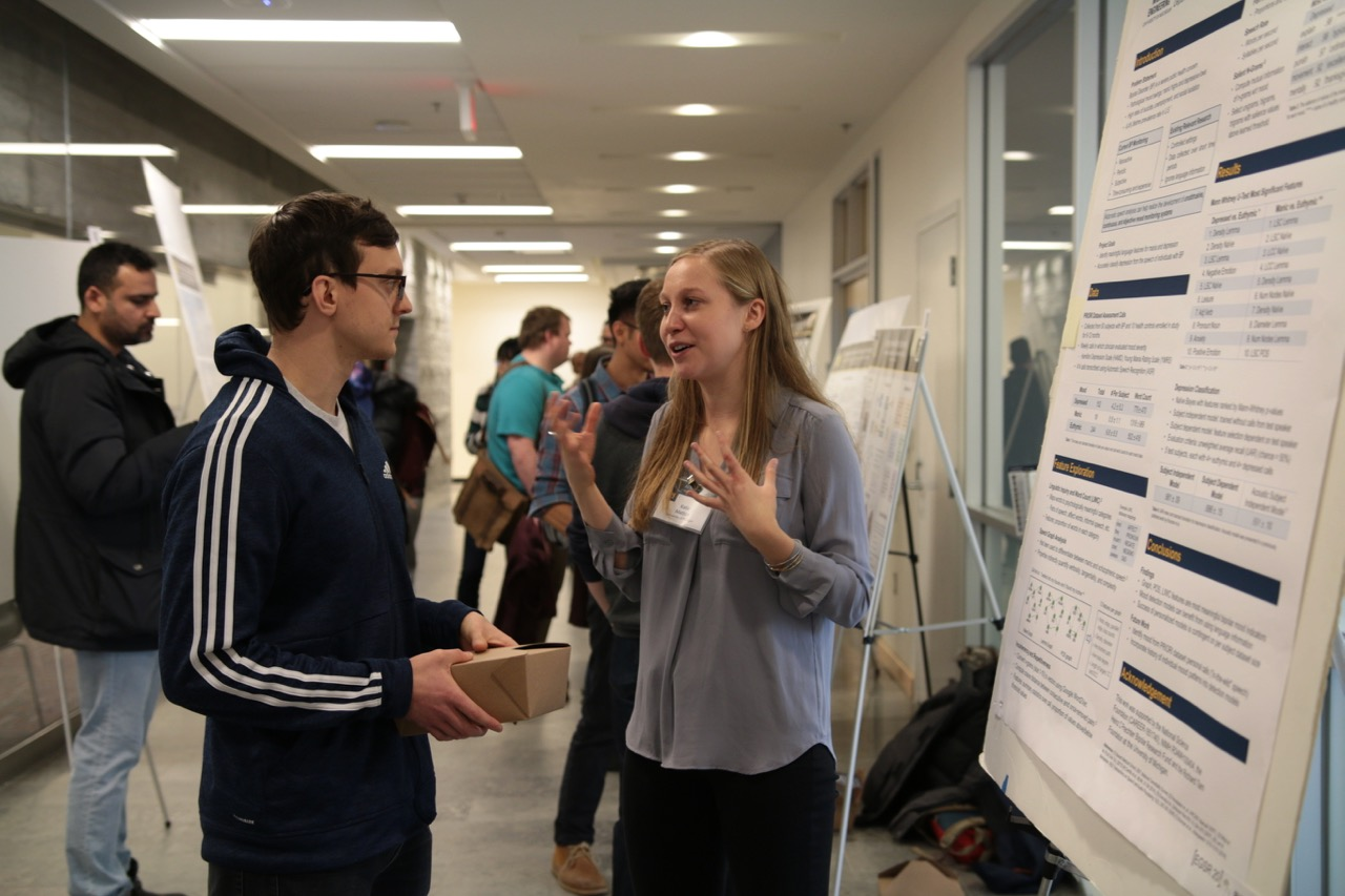 Students share ideas at the poster session.
