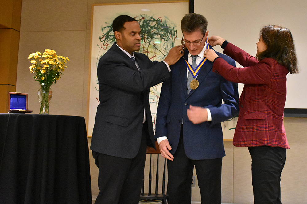 Dean Gallimore and Professor Liu present Professor Lafortune with his medal.