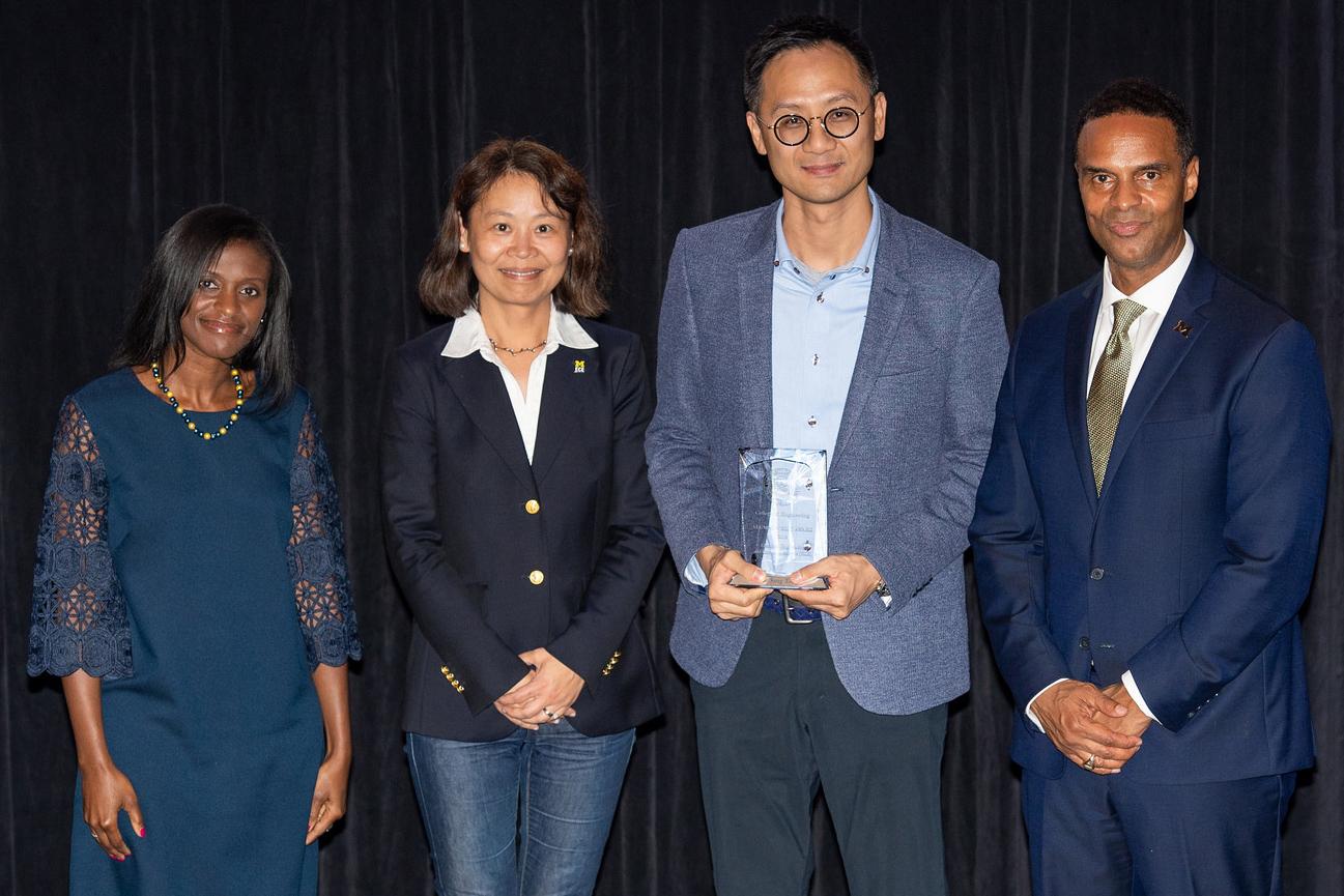 Dowson Tong Accepts Award