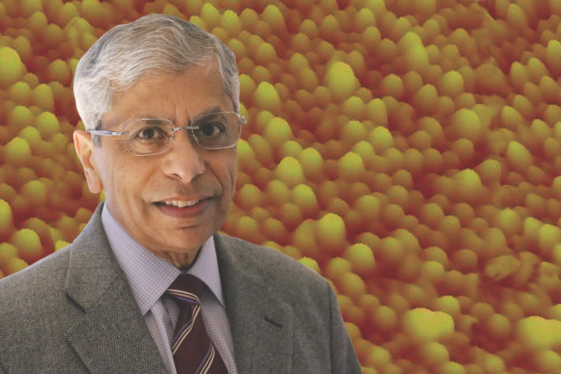 Prof. Pallab Bhattacharya with a background of quantum dots for red-emitting diode lasers.