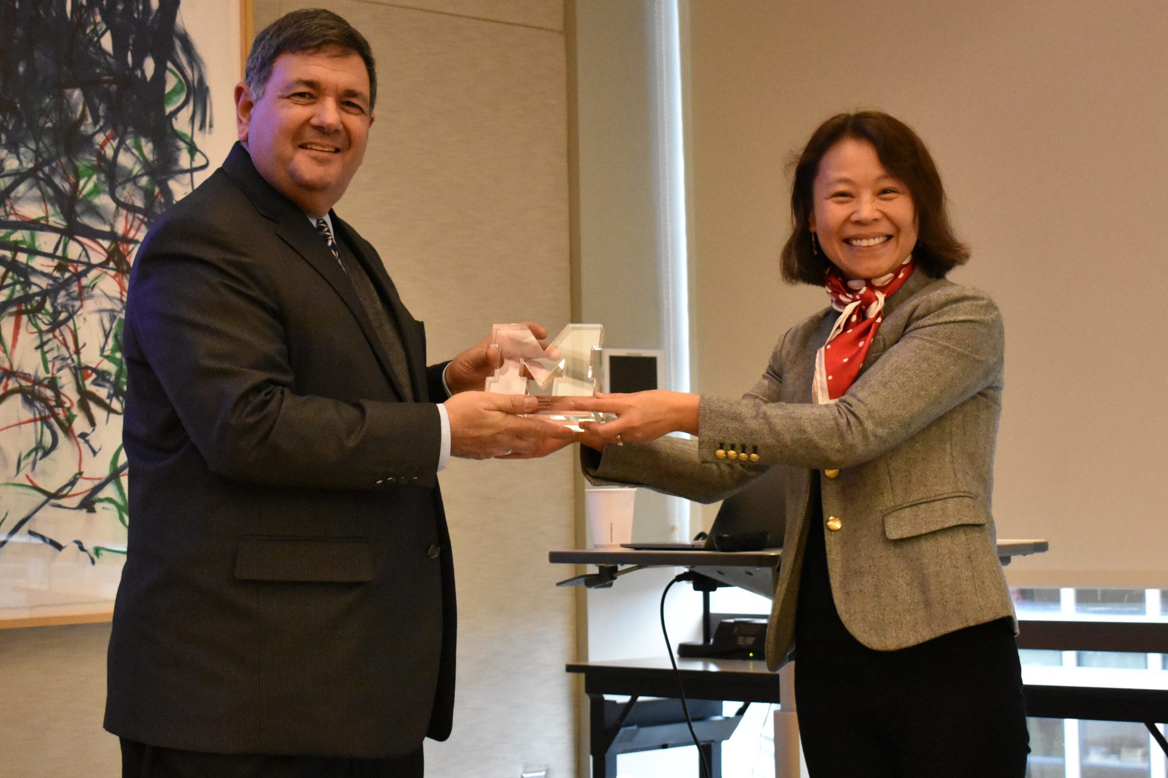 Mingyan Liu presents the Honorable Zachary Lemnios with the ECE Alumni Impact Award