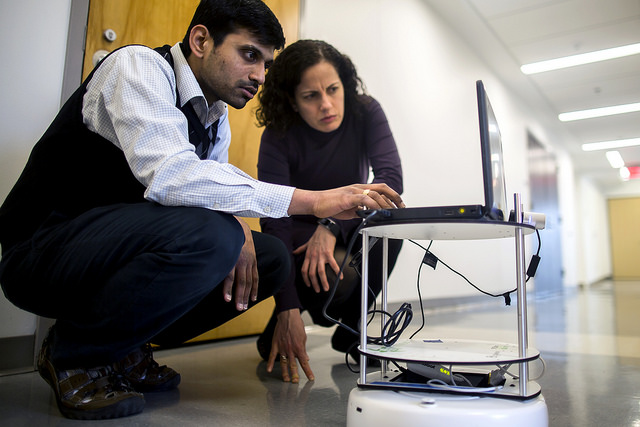 Carol Menassa, CEE Professor, and Baddu Mantha, CEE PhD Student, test an environmental data collection robot their research. Photo: Joseph Xu