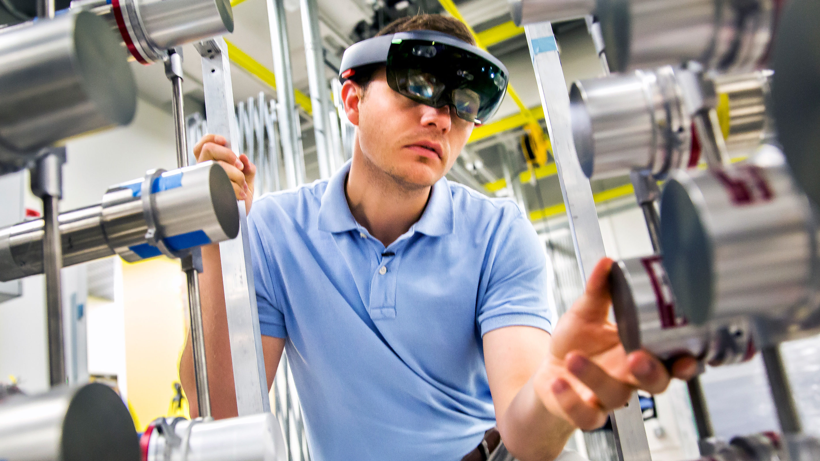 Michael Hamel, NERS Ph.D. Student, uses a Microsoft Hololens headset with a radiation imaging array to demonstrate the use of augmented reality to find nuclear materials hidden in a room. Photo: Joseph Xu