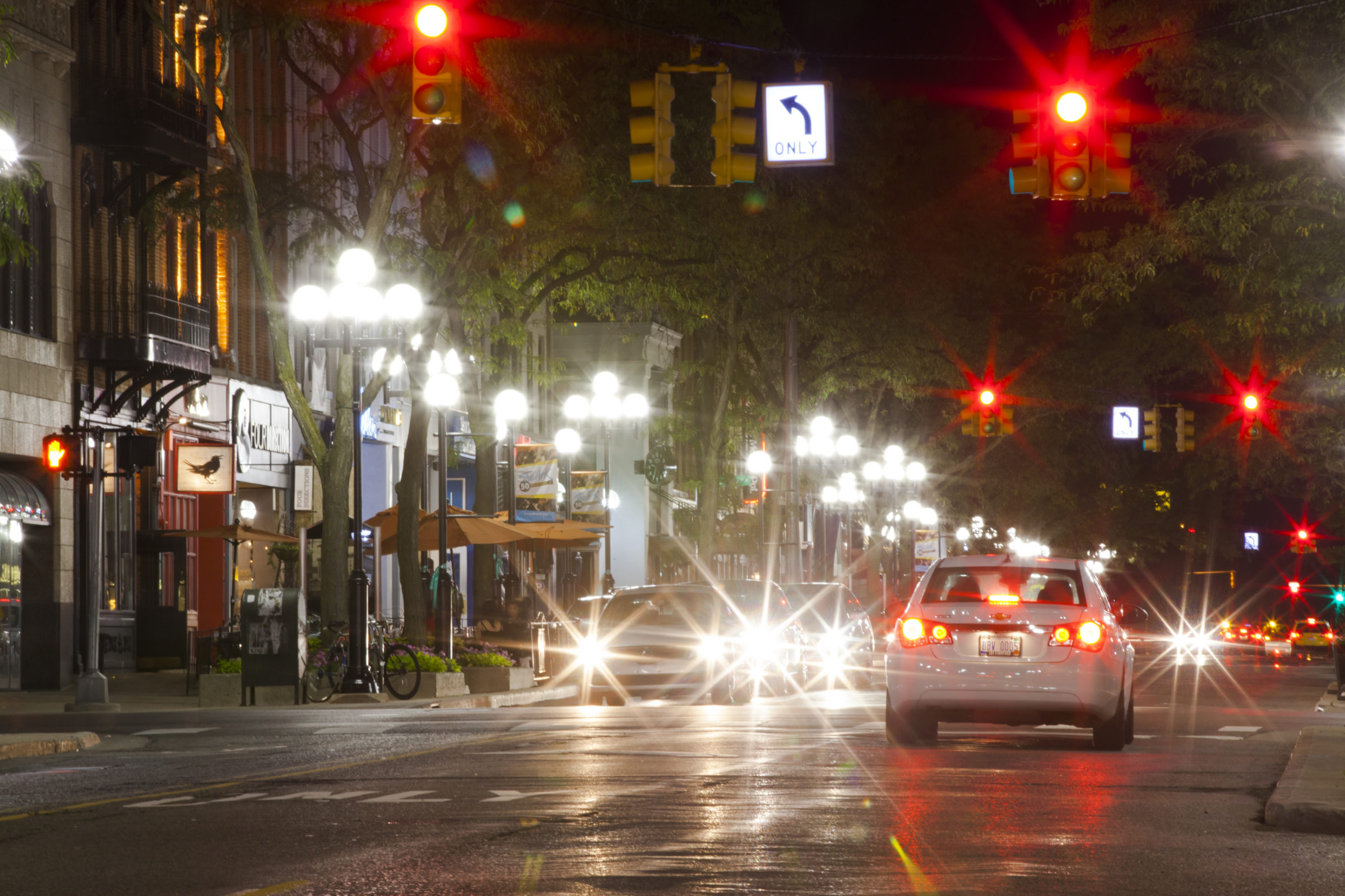 Photo of Ann Arbor intersection at night.