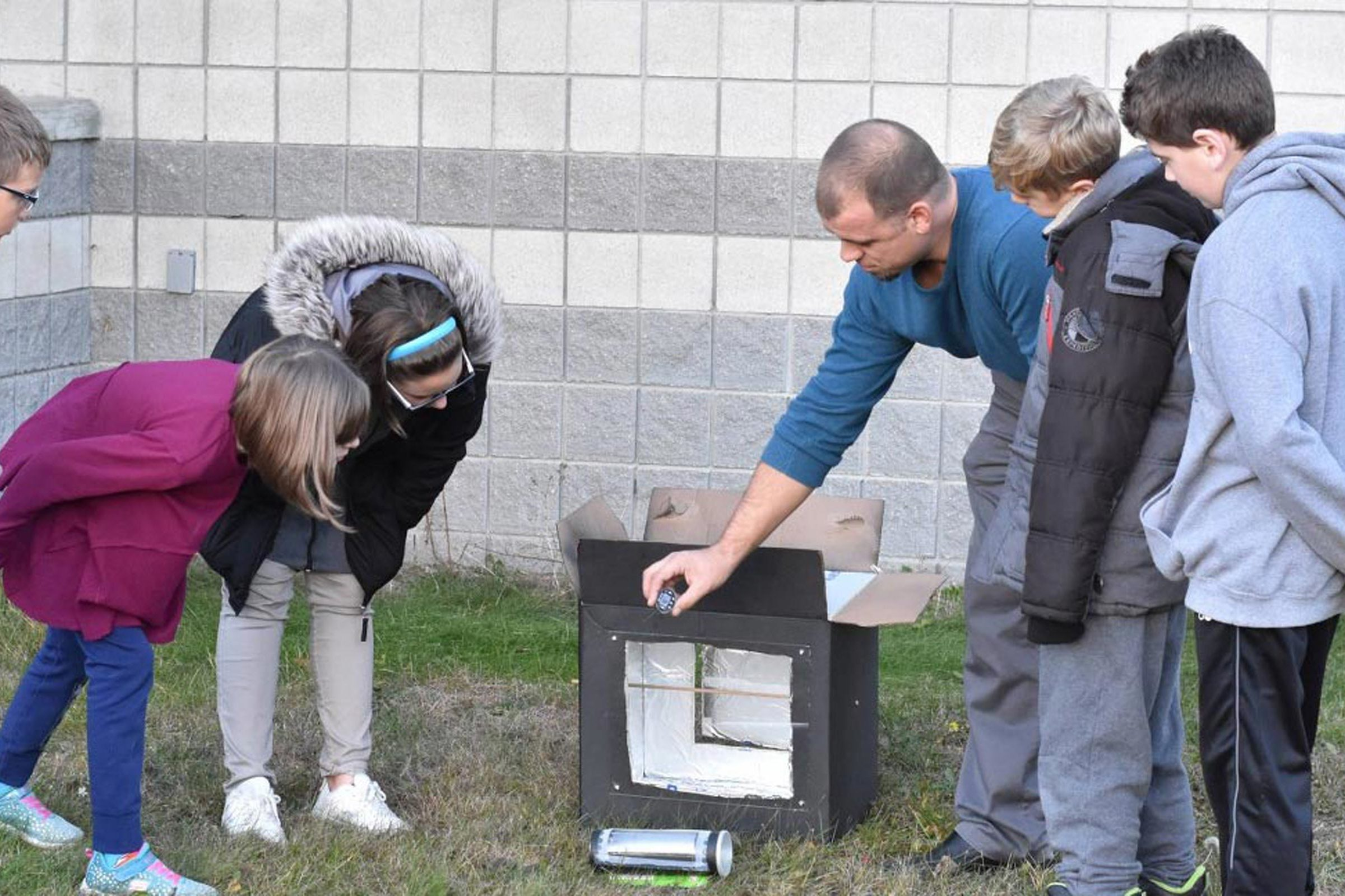Aerospace Engineering Prof. James W. Cutler help FIRST LEGO team build solar oven