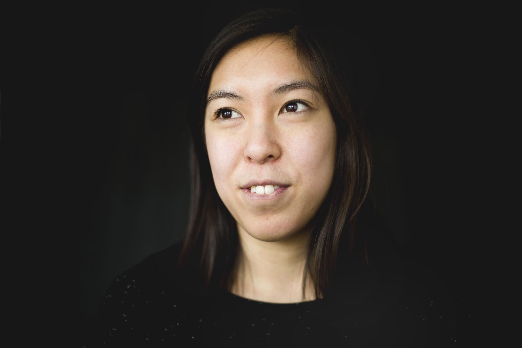 A portrait of a female graduate student.