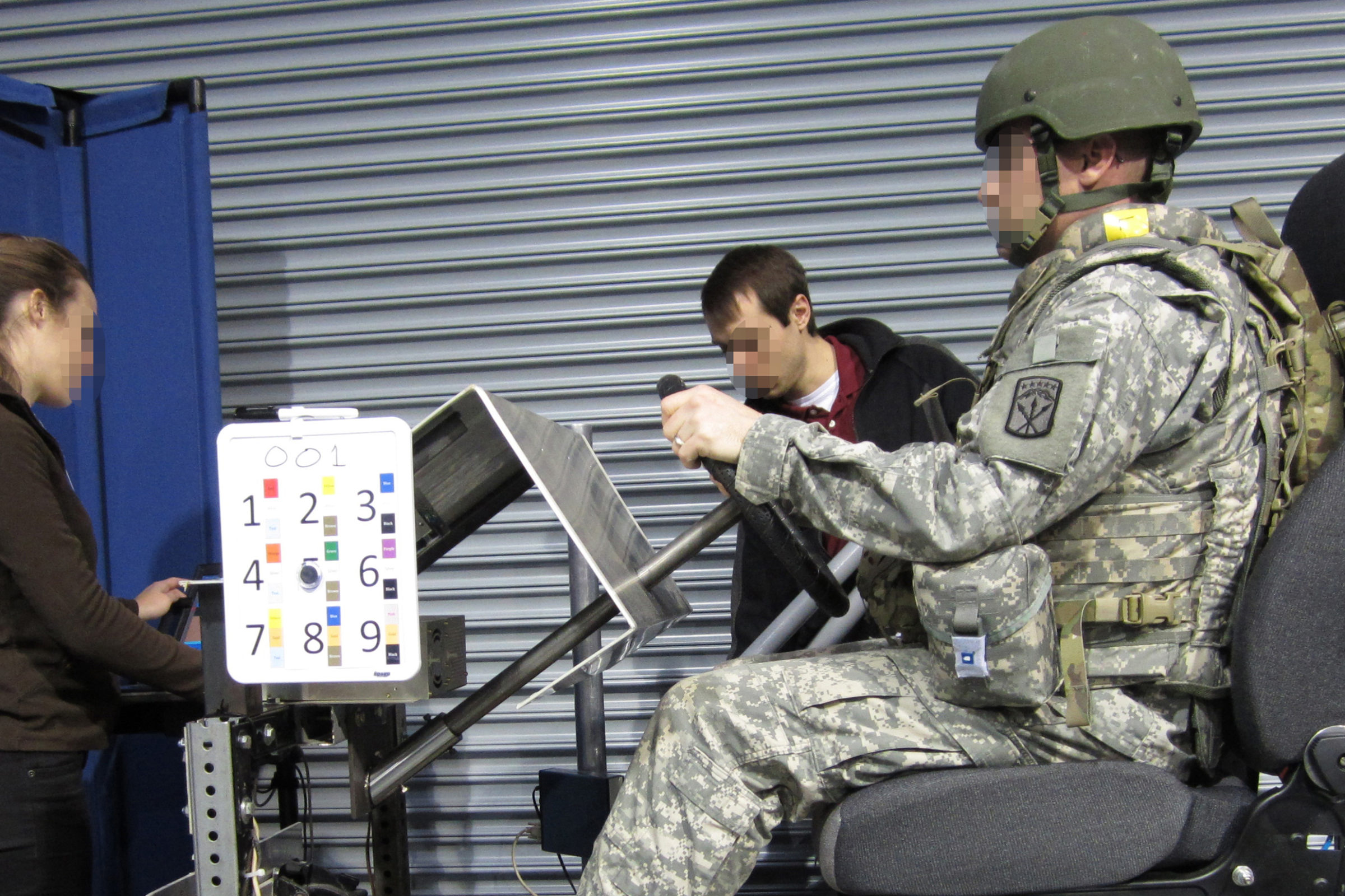 A person in a military uniform sits in a chair during the experiment