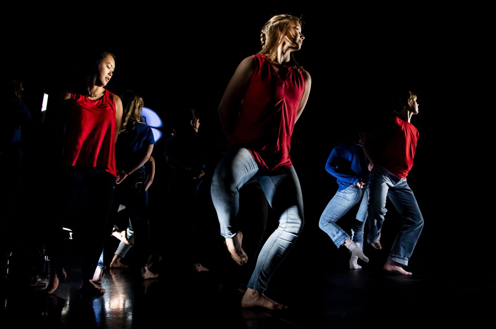 A photograph of dancers performing physics principles.