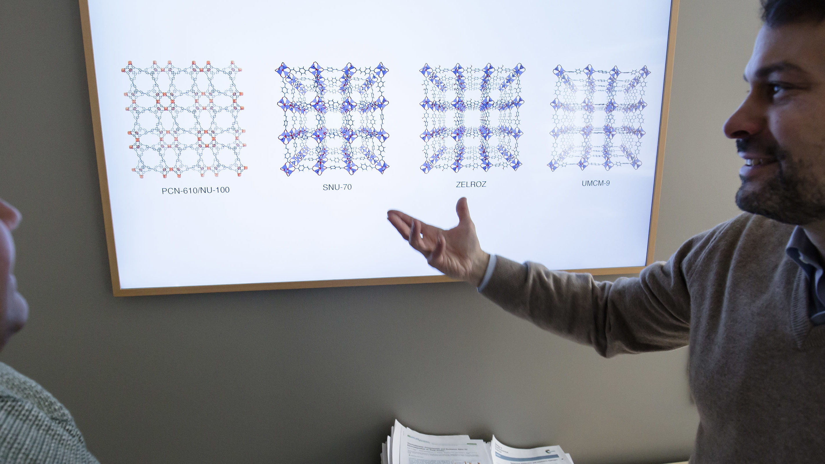 Alauddin Ahmed, an assistant research scientist, and Donald Siegel, an associate professor, show off the results of a computational metal-organic framework (MOF) study.