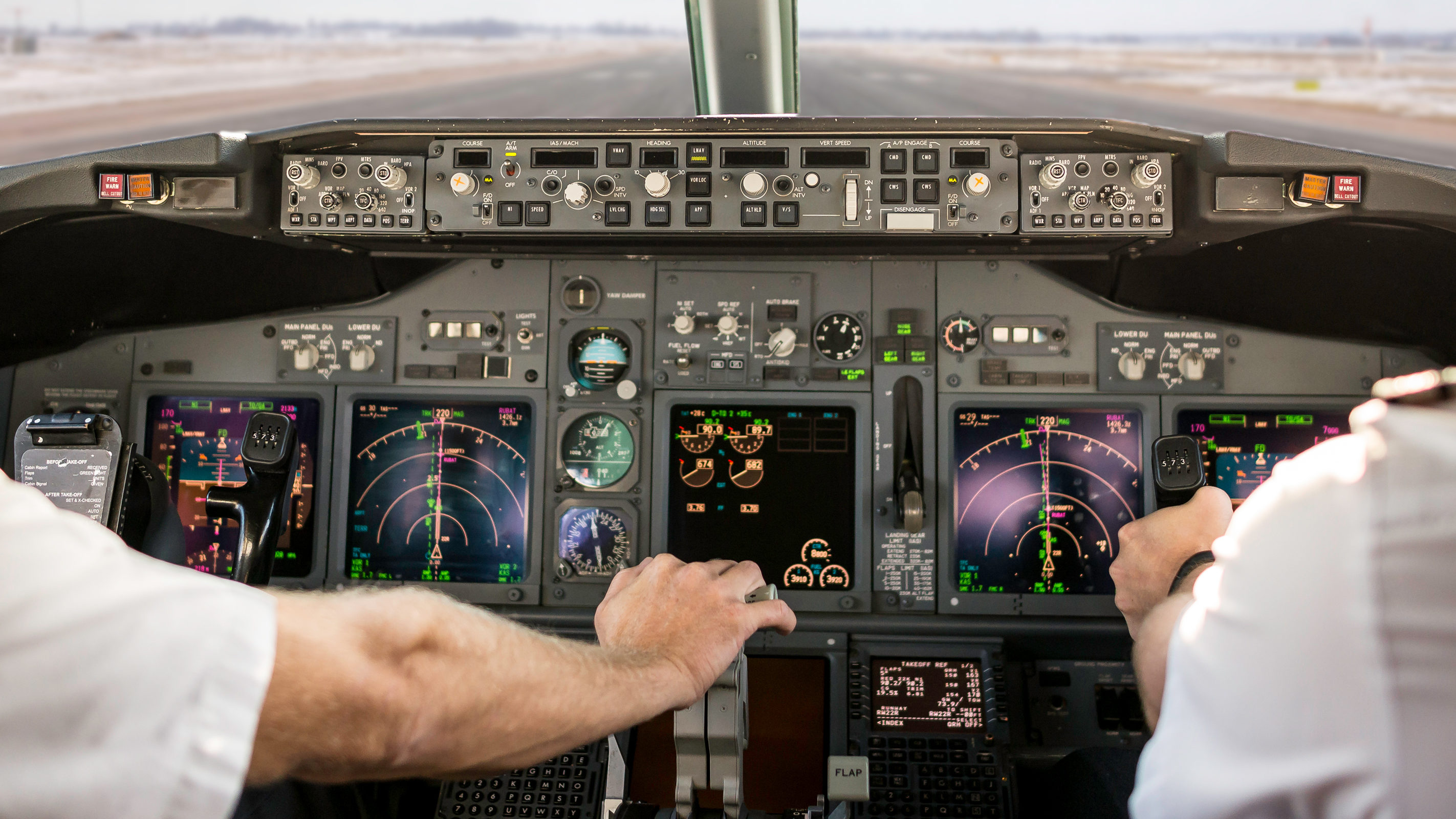Captain is pulling an aircraft throttle, while first officer is piloting and taking off. Pilots are sitting in Boeing 737-800. Getty Images