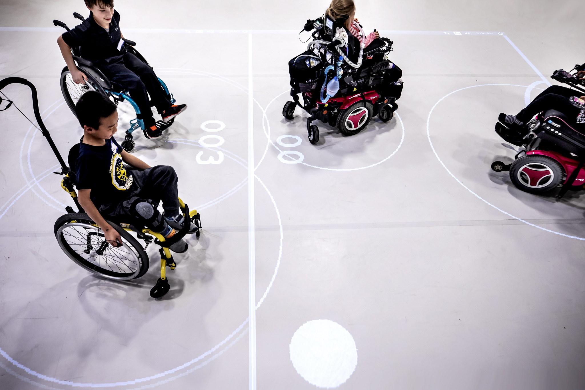 A photograph of children in wheelchairs playing an augmented reality game.