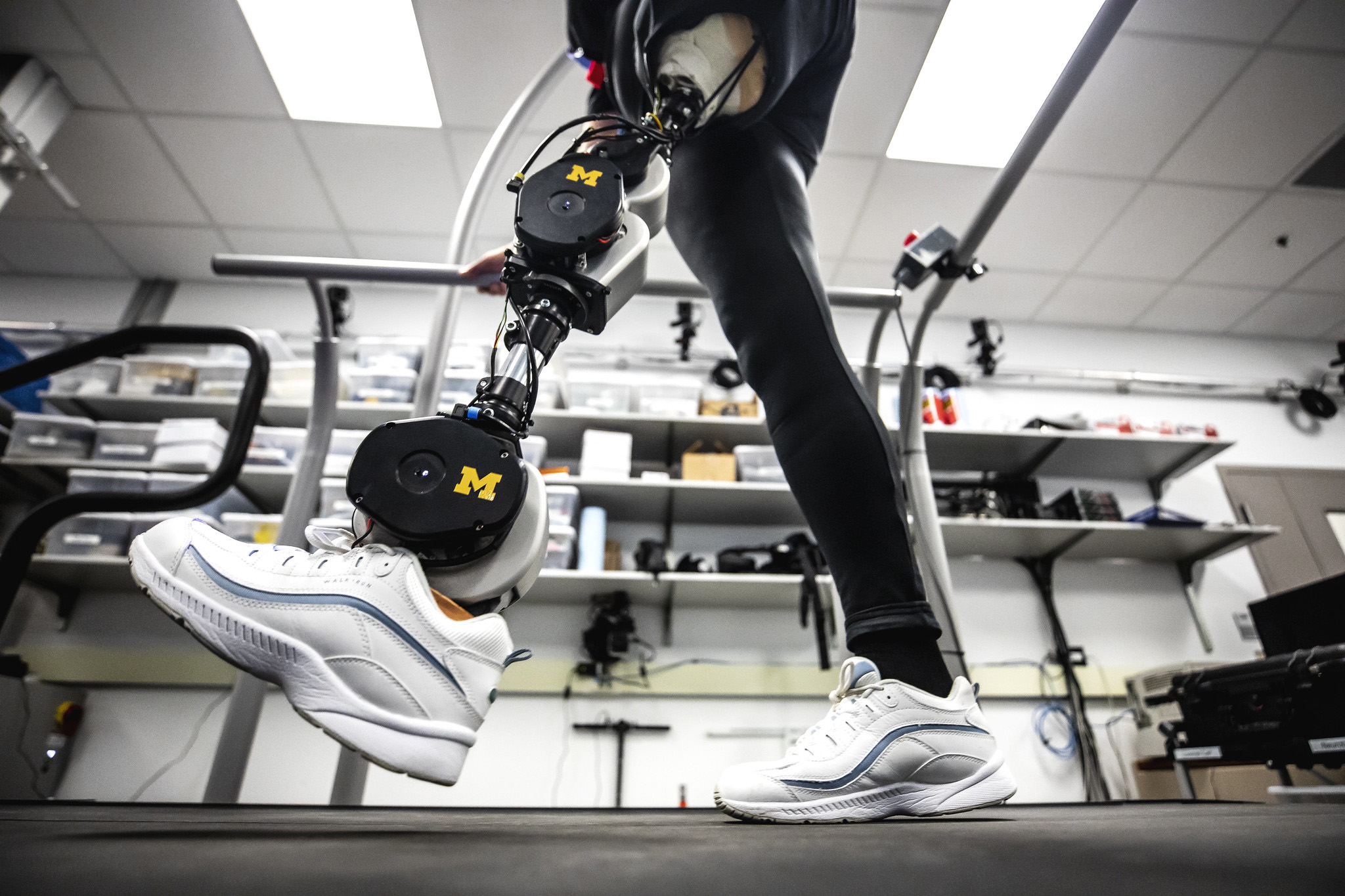 A photograph of a bionic leg being tested in lab.