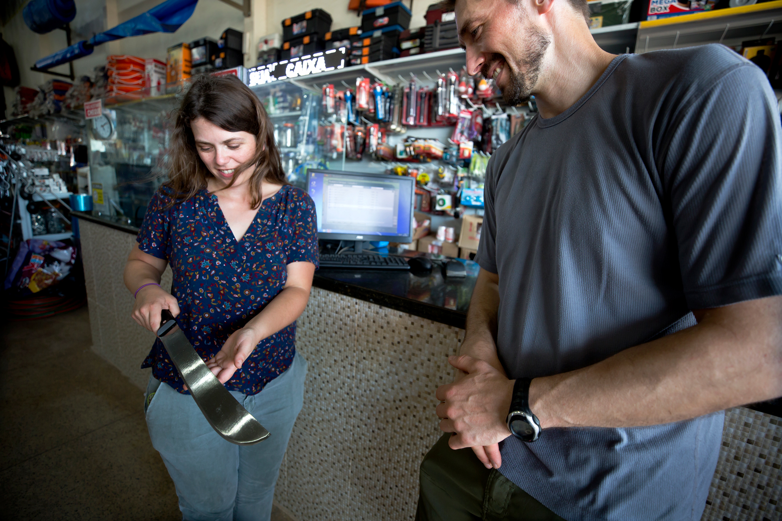 Agee handling a machete in a gear shop. Photo: Joseph Xu/Michigan Engineering