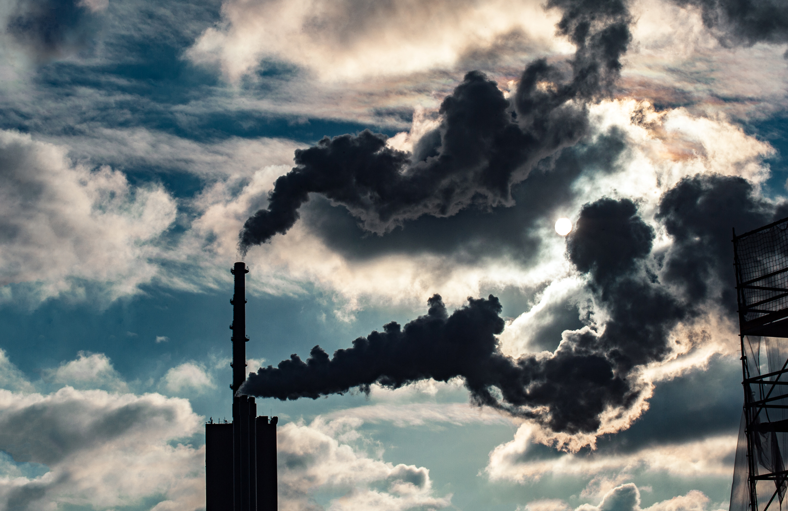 Smoke rises into the sky from a power plant