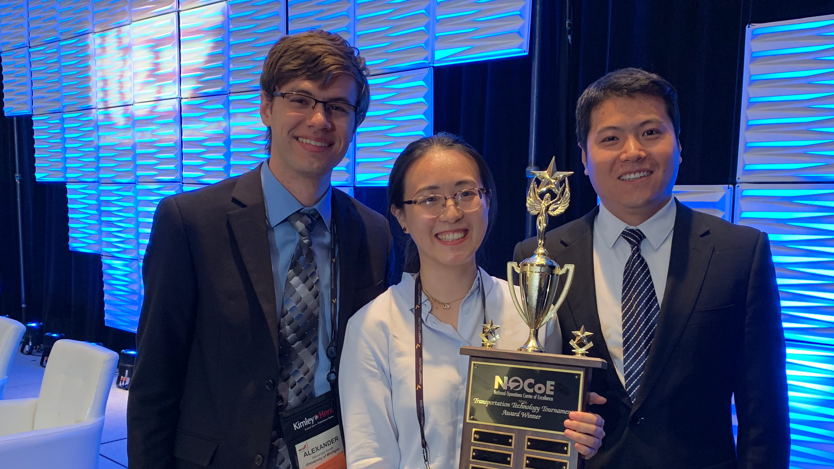 University of Michigan team members Alex Sundt, Xiatong Sun and Yan Zhao with their trophy. Photo: Adam Hopps, National Operations Center of Excellence